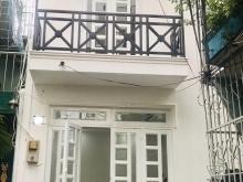 Hẻm trước nhà 4m,giáp Q.1,nhà mới,đẹp,gần mặt tiền:bán gấp nhà Phú Mỹ,BT giá sốc